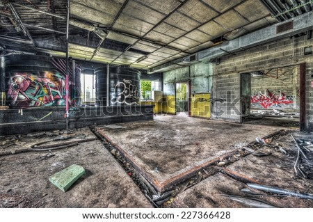 Dilapidated workshop in an abandoned factory, ,HDR - stock photo