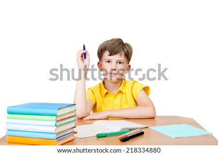 diligent pupil at the table with textbooks and notebook  - stock photo