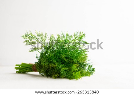 Dill on the wooden table - stock photo