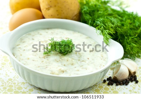 Dill soup with egg and potatoes in a white bowl.