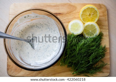 Dill sprigs and chopped lemon ingredients - stock photo