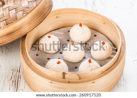 Dim sum bamboo tray with dim sum on background - stock photo