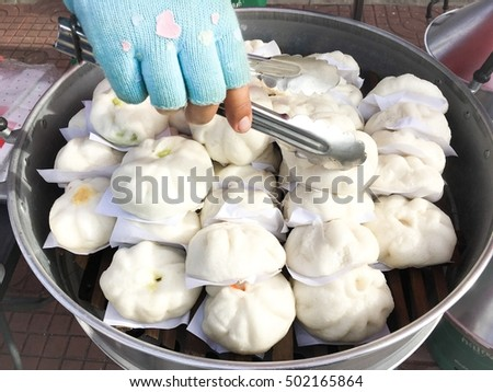 Dim Sum, buns in steam boiler, steamed stuff buns or  steamed dumpling buns on street food, steamed bun's best food, Nikuman in Japanese langue.