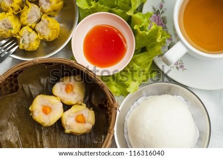 Dim sum, Chinese steamed pork , shrimp dumplings and steamed buns - stock photo