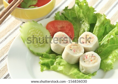 Dim sum in white dish  near Chili sauce and Vegetables. - stock photo