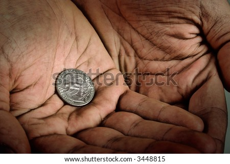 Dime in old dirty hands. High contrast black and white - stock photo