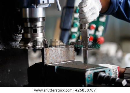 Dimension check on milling machine by vernier