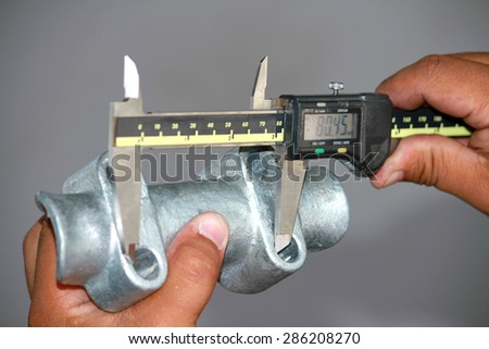 Dimension Check steel hardware by vernier - stock photo