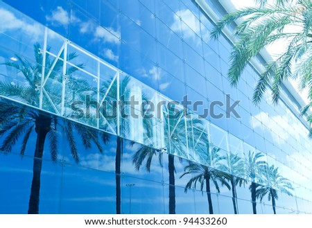 diminishing blue glazed wall of contemporary business building - stock photo
