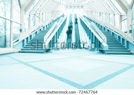 diminishing moving escalator in office center - stock photo