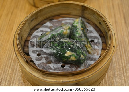 Dimsum in the steam basket . Chinese dimsum bamboo steamer - stock photo