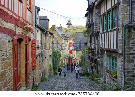 DINAN, FRANCE -28 DEC 2017- Cobbled street and Middle Ages buildings in Dinan, a picturesque medieval town of Dinan on the River Rance in the Cotes d'Armor, Brittany, France.