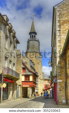 DINAN, FRANCE - JUNE 29, 2015: Tourists in the streets of the old town. Dinan is a walled Breton town and first-class tourist attraction in Brittany, northwestern France.