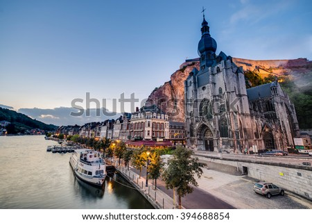 DINANT, BELGIUM - JUNE 15, 2014: The Collegiate Church of Notre-Dame is the most important landmark of Dinant, located in the Waloon region, Belgium - stock photo