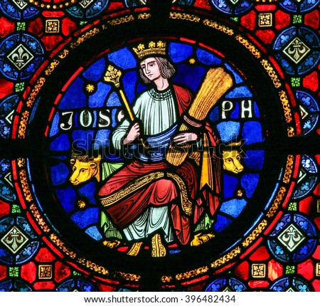 DINANT, BELGIUM - OCTOBER 16, 2011: Joseph (son of Jacob), son of Jacob in the Hebrew Bible book of Genesis, depicted on a stained glass window in Dinant, Belgium. - stock photo