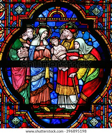 DINANT, BELGIUM - OCTOBER 16, 2011 Stained glass window depicting Joseph and Mary presenting the Child Jesus to Saint Ana and Joachim, in the Notre Dame church in Dinant, Belgium - stock photo