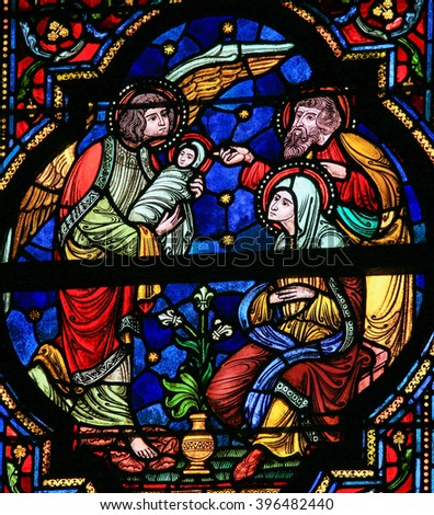 DINANT, BELGIUM - OCTOBER 16, 2011 Stained glass window depicting Joseph, Mary, Gabriel and Jesus in the Notre Dame church in Dinant, Belgium - stock photo