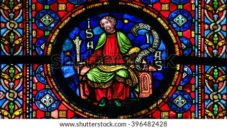 DINANT, BELGIUM - OCTOBER 16, 2011: Stained glass window depicting the prophet Isaiah in the cathedral of Dinant, Belgium. - stock photo