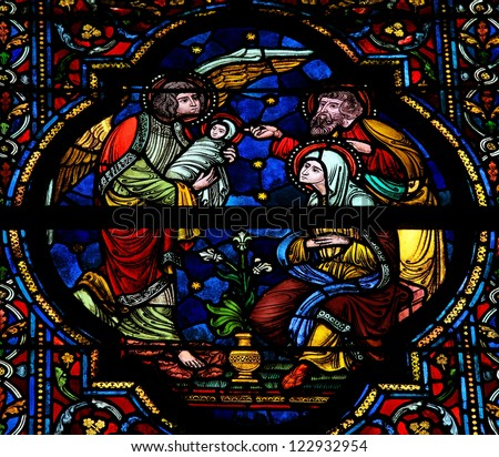 DINANT - OCTOBER 16: Stained glass window depicting a Nativity Scene in the Notre Dame church in Dinant, Belgium, on October 16, 2011. - stock photo