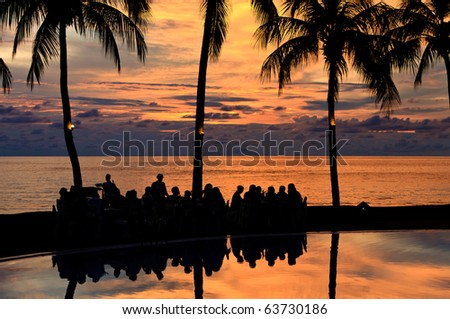 Diner on the beach at  a sunset