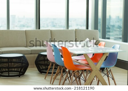 dining and living room with colorful chair - stock photo