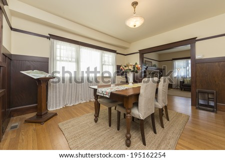 Dining area dining room with wooden floor in craftsman style home - stock photo