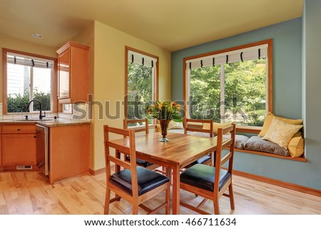 Dining area with wooden table set and cozy sitting place. Northwest, USA