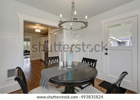 Dining black round table with four cushioned chairs in classic American Dining room. Northwest, USA