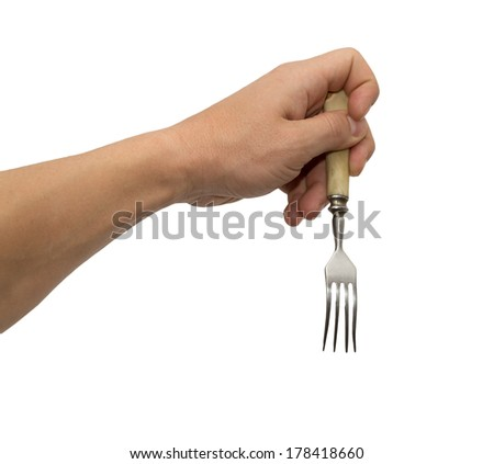 dining fork in hand on white background - stock photo