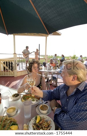 dining outside on the deck of a bayside restaurant
