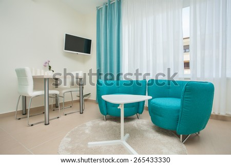 dining room and living room in an modern apartment  - stock photo