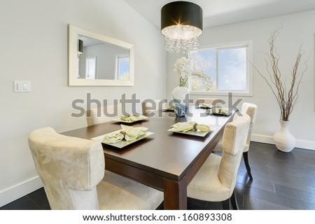 Dining room in a luxury house. - stock photo