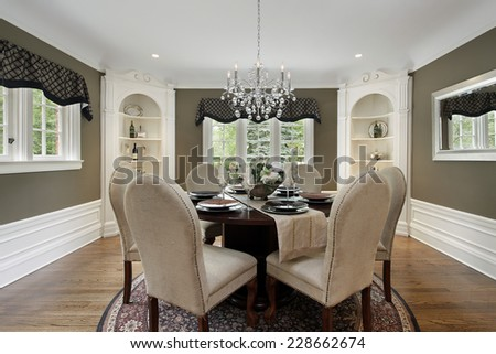 Dining room in luxury home white cabinetry - stock photo