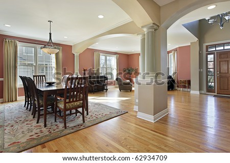 Dining room in open floor plan with foyer view - stock photo
