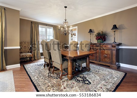 Dining room in upscale home with tan walls.