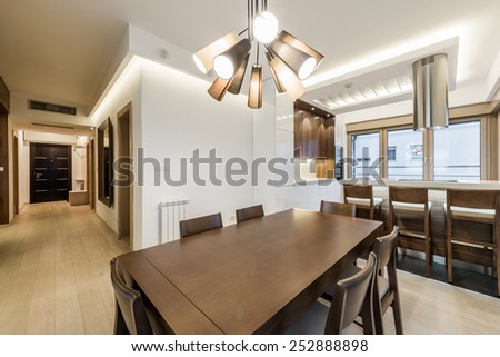 Dining room interior in modern bright apartment
