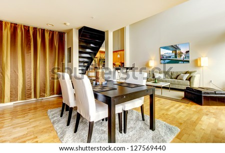 DIning room interior in modern city apartment with high loft ceiling. - stock photo