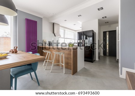 Dining Room Kitchen And Entrance In Contemporary Family House With Minimalist Gray Design Colorful