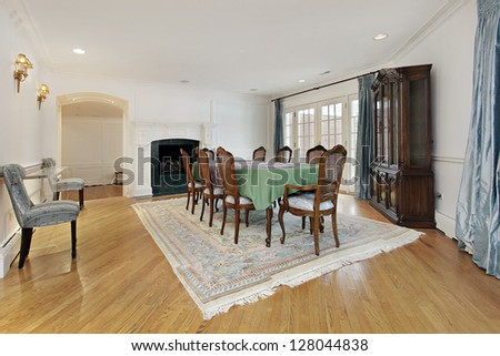 Dining room with fireplace and doors to patio - stock photo