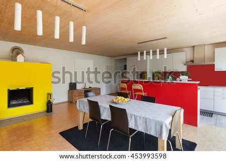 Dining room with kitchen of a modern house, interior