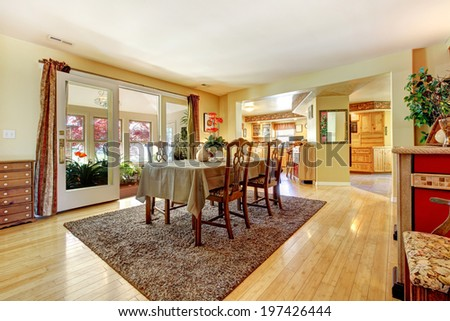 Dining room with open door to greenhouse. Furnished with antique dining table set
