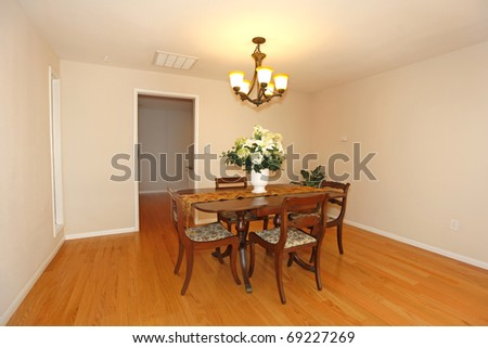 Dining room with  table and chairs in an empty house