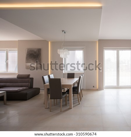 Dining space arranged in commodious modern furnished house