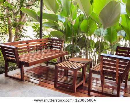 dining table and chair in the garden - stock photo