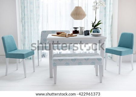 dining table and comfortable chairs in modern home with elegant table ...