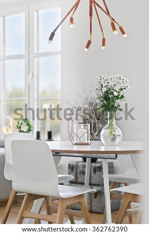 Dining table in clean, modern interior - stock photo