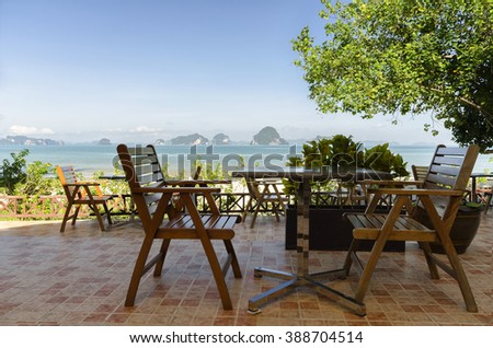 Dining table on the patio of beach resort in Krabi Thailand - stock photo
