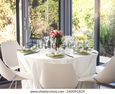 Dining table set for a wedding or corporate event - stock photo