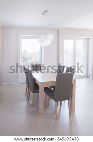 Dining table set in bright luxury interior