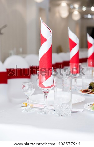 Dining table setting at Provence style, with candles, lavender, vintage crockery and cutlery, closeup. Serving a festive table in restaurant - stock photo